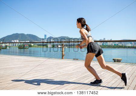 Woman running at seaside walk
