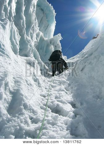 Climber the climb on glacier