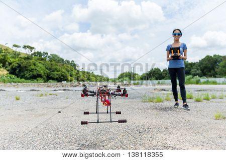 Woman controling a drone