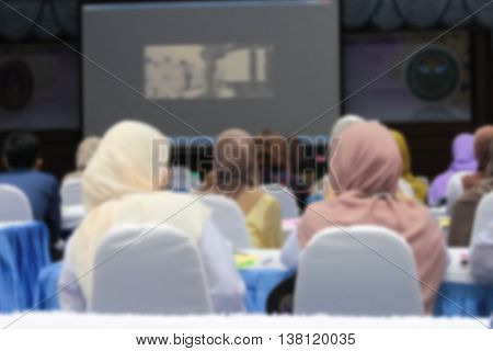 blur blurred abstract at Business students conference education training hall or room seminar meeting People Analyzing Statistics Financial Concept with an attendee.
