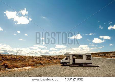 Motorhome or campervan parking by roadside in New Zealand poster