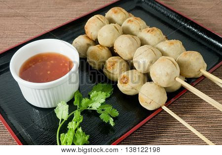 Food and Cuisine Grilled Meatballs on Wooden Skewer Served with Sweet Spicy Sauce and Green Coriander.