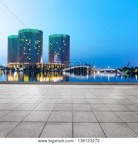 modern abstract office buildings in hangzhou West Lake culture plaza at twilight on view from empty street