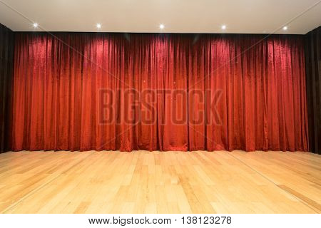 empty wood stage with red curtain background