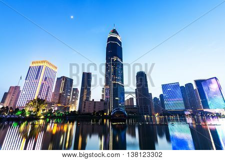 modern abstract office buildings in hangzhou West Lake culture plaza at twilight