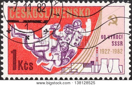 MOSCOW RUSSIA - DECEMBER 2015: a post stamp printed in CZECHOSLOVAKIA shows spacemen and devoted to the 65th Anniversary of October Revolution and the 60th Anniversary of the U.S.S.R circa 1982