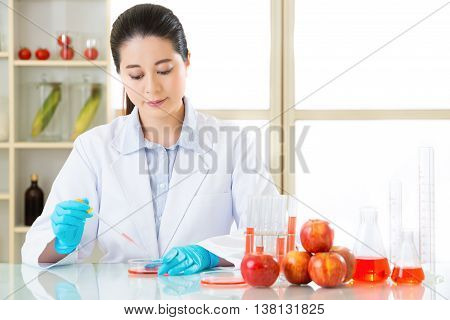 Asian female scientist research for genetic modification solution in laboratory poster