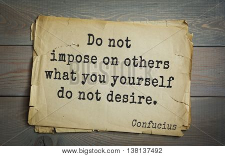 Ancient chinese philosopher Confucius quote on old paper background. Do not impose on others what you yourself do not desire.