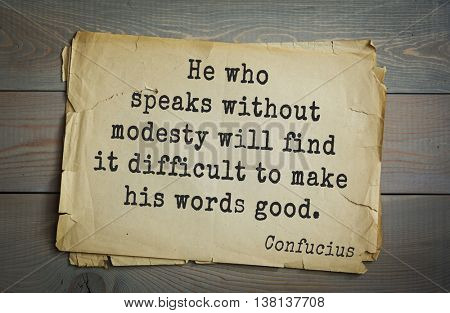 Ancient chinese philosopher Confucius quote on old paper background. He who speaks without modesty will find it difficult to make his words good.