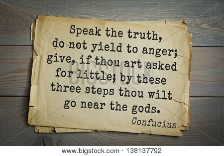 Ancient chinese philosopher Confucius quote on old paper background. Speak the truth, do not yield to anger; give, if thou art asked for little; by these three steps thou wilt go near the gods.