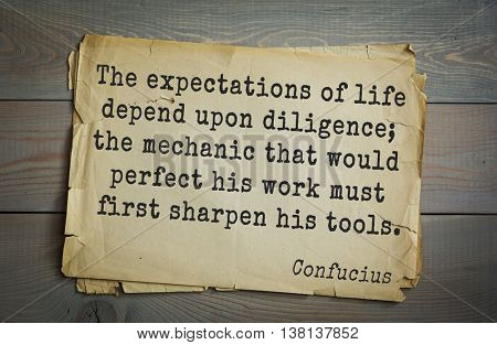 Ancient chinese philosopher Confucius quote on old paper background. The expectations of life depend upon diligence; the mechanic that would perfect his work must first sharpen his tools.