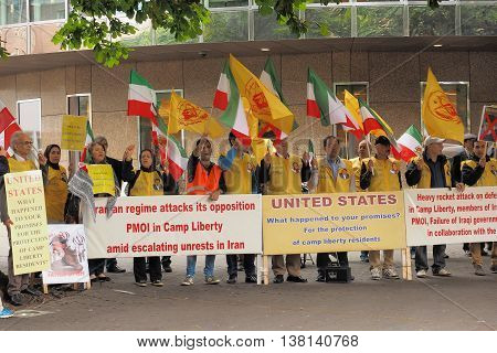 The Hague Netherlands - July 5 2016: Iranian protesters at the Hofplaats besides the Dutch parliament in The Hague demonstrating against the recent bombing of camp liberty in Iraq