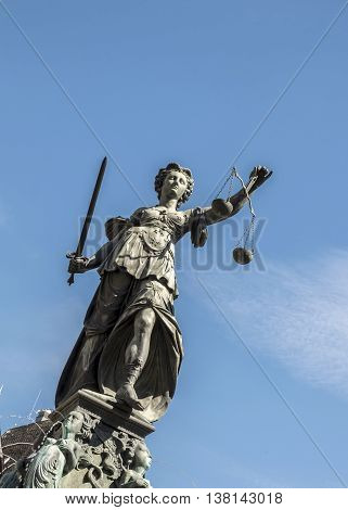 Justitia - Lady Justice sculpture on the Roemerberg squareStatue of Lady Justice (Justitia) in Frankfurt Germany