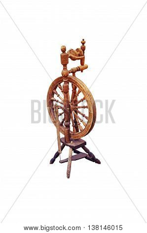 old wooden spinning wheel isolated on a white background