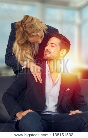 Businesswoman is seducing her boss at office in sunset