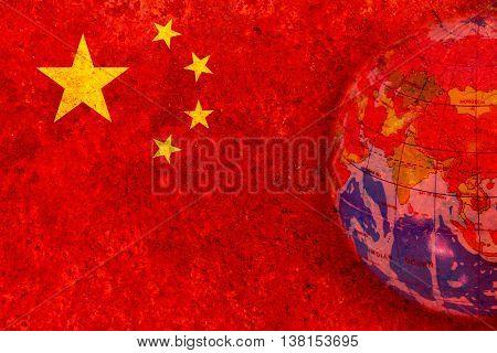 China - January 15 2015. globe in rustic chinese flag blackground