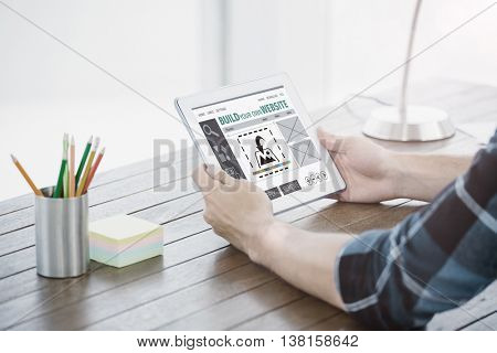 Composite image of build website interface against close up of hands using a tablet computer Close up of hands using a tablet computer on the modern desk