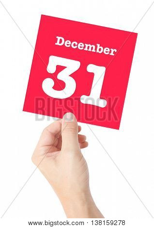 December 31 written on a card held by a hand