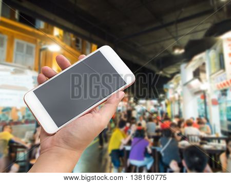 Mobile Smartphone With Food Stall Background