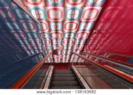 NAPLES ITALY - JUNE 25: University Metro Station in Naples on JUNE 25 2014. Escalators in Universita Art Station Designed by Architect Karim Rashid in Naples Italy.
