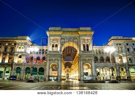 MILAN ITALY - NOVEMBER 24: Galleria Vittorio Emanuele II shopping mall entrance early in the morning on November 24 2015 in Milan Italy.