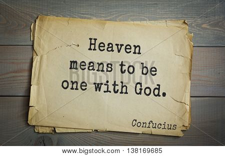 Ancient chinese philosopher Confucius quote on old paper background. Heaven means to be one with God.