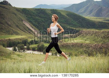 Young Sporty Woman Running Outdoor.