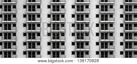fictitious 3D rendering of a highrise facade with anonymous apartments with balcony