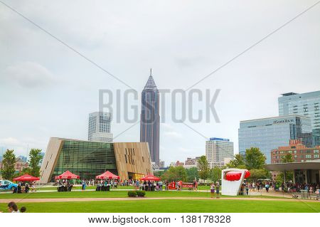 ATLANTA - AUGUST 29: World of Coca-Cola in Centennial Olympic park with people on August 29 2015 in Atlanta GA.