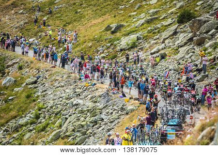 Col de la Croix de Fer France - 25 July 2015: The peloton riding in a rocky natural environment at Col de la Croix de Fer in Alps during the stage 20 of Le Tour de France 2015.