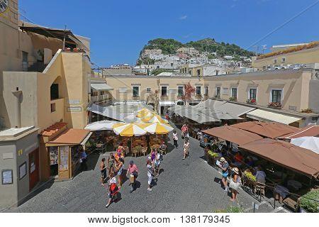CAPRI ITALY - JUNE 26: La Piazzetta in Capri on JUNE 26 2014. Tourists at Square With Restaurants at Top of Island in Capri Italy.