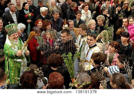 Uzhgorod Ukraine - April 13. 2014: Greek Catholic parish congregation celebrate Palm Sunday one week befor Easter.