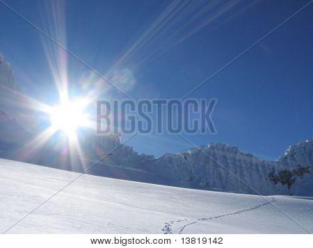 Sun and snow mountains landscape