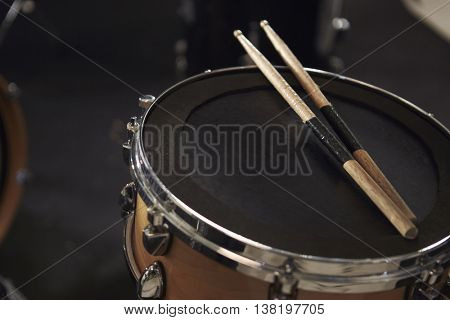 Close Up Of Sticks Resting On Snare Drum