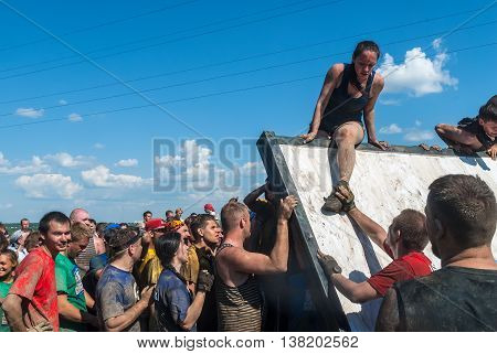 Tyumen, Russia - July 9, 2016: Steel Character extrim race on Voronino Hill. Athletes climb on inclined wall