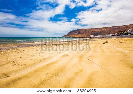 Fishing village Pozo Negro with stone and sand beach Fuerteventura Canary Island Spain.