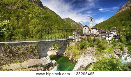 View To Lavertezzo Village, Famous Swiss Village With Double Arch Stone Bridge At Ponte Dei Salti Wi