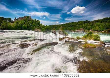 View to Rhine falls (Rheinfalls) the largest plain waterfall in Europe. It is located near Schaffhausen between the cantons of Schaffhausen and Zurich