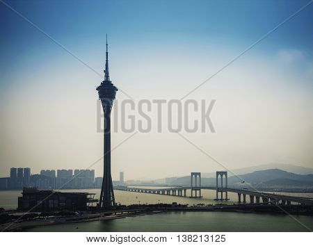macau tower urban landmark skyline and taipa bridge in macao china