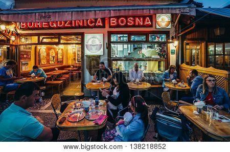Sarajevo Bosnia and Herzegovina - August 23 2015. People sits in restaurant at Bascarsija area in Sarajevo