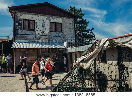 Sarajevo Bosnia and Herzegovina - August 24 2015. Tourists in front of museum of underground tunnel constructed by Bosnian Army during the Siege of Sarajevo