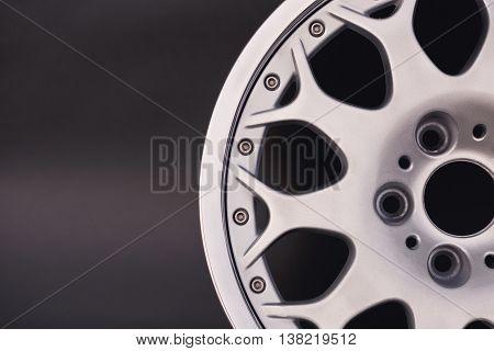 Aluminum metal wheel rim texture. Car alloy wheel, isolated on black background