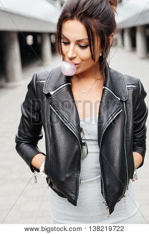 Sexy Beautiful Brunette Woman Blowing Bubblegum
