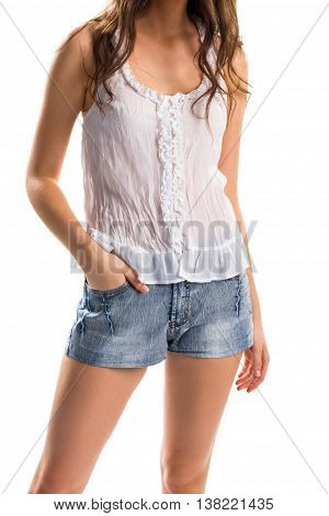 Woman in white blouse. Sleeveless top and short shorts. Light apparel for summer. Model wears cotton clothing.