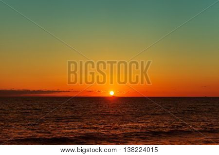 Tropical sunset on the beach at Sunset Cliffs in San Diego California