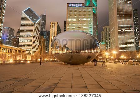 CHICAGO, IL - MARCH 31, 2016: Cloud Gate in the nighttime. Cloud Gate is a public sculpture by Indian-born British artist Anish Kapoor.
