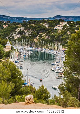 The fjord in Calanque National Park between Cassis and Marseille.  White and graceful sailing yachts in turquoise water of the gulf