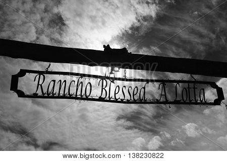 Rancho Blessed A Lotta wooden driveway signpost