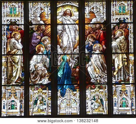 SAVANNAH GEORGIA JUNE 28 2016: Stained glass window at The Cathedral of St. John the Baptist is a Roman Catholic cathedral. It is the Mother Church of the Roman Catholic Diocese of Savannah.
