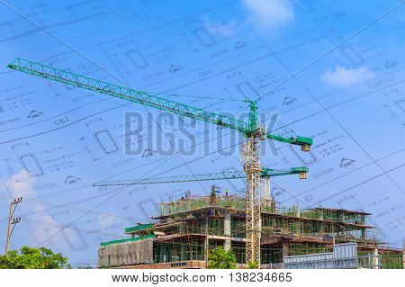 Crane working in construction on blue sky